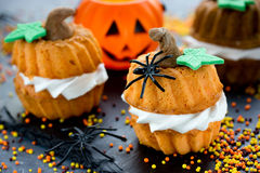 Halloween pumpkin cupcake - funny sweet treats for kids Royalty Free Stock Images
