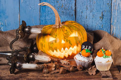 Halloween pumpkin and cupcakes with colored decorations Royalty Free Stock Photo
