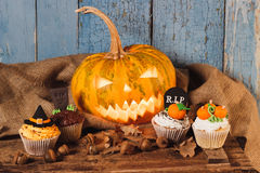 Halloween pumpkin and cupcakes with colored decorations Royalty Free Stock Image
