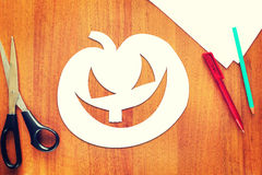 Halloween pumpkin cut out of paper lying on a table Royalty Free Stock Photo