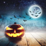 Halloween Pumpkin in a dark mist Forest. Elements of this image furnished by NASA. Halloween Pumpkin in a dark mist Forest. Studio shot. Elements of this image Royalty Free Stock Photo
