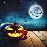 Halloween Pumpkin in a dark mist Forest. Elements of this image furnished by NASA stock image