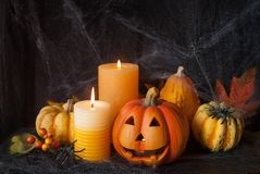 Halloween pumpkin decor with candle. And spiders stock photography
