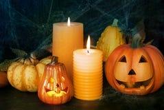Halloween pumpkin decor with candle and spiders. Halloween decorative pumpkin with candle and spiders Stock Photos