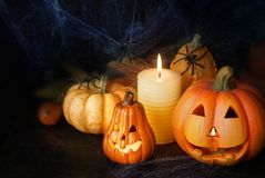 Halloween pumpkin decor with candle and spiders. Halloween decorative pumpkin with candle and spiders Stock Photography