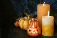 Halloween pumpkin decor with candle. And spiders. Place for text Royalty Free Stock Photography