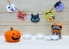 Halloween doll. Halloween pumpkin doll with candle and flag for decoration on Halloween day on wooden background Stock Images