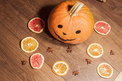 Halloween pumpkin and dry fruits Royalty Free Stock Image
