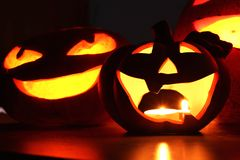 Halloween pumpkin face and candles close-up Stock Image