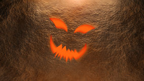 Halloween pumpkin face wall Stock Image
