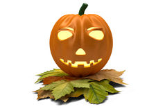 Halloween pumpkin with fallen leaves isolated on Stock Photography