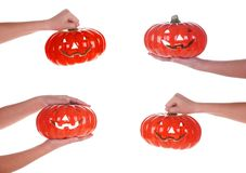 Halloween pumpkin in a female hand, isolated Stock Photography