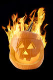 Halloween pumpkin on fire Royalty Free Stock Photos