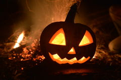 Halloween pumpkin with fire. On background Royalty Free Stock Images