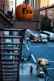 Halloween pumpkin on a fire escape of a building in New York Stock Images