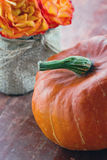 Halloween pumpkin and flowers on wooden background Stock Photography