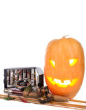 Halloween pumpkin with fly-fishing on white Royalty Free Stock Image