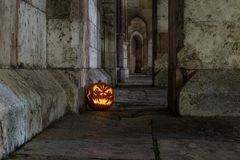 Halloween pumpkin in front of ancient stone wall of a church, Germany Royalty Free Stock Photos