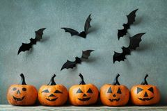 Halloween pumpkin with funny smile and bats. Spooky holidays decoration. Royalty Free Stock Photography
