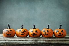 Halloween pumpkin with funny smile on wooden table. Royalty Free Stock Images