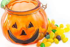 Halloween Pumpkin glass with jelly beans isolated Stock Images