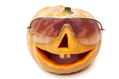 Halloween pumpkin with glasses Royalty Free Stock Images