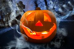 Glowing Halloween pumpkin. Halloween pumpkin glowing in the dark forest Stock Photography