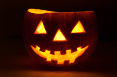Halloween pumpkin glowing in the dark Stock Image
