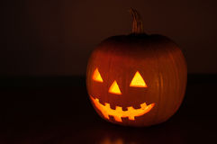 Halloween pumpkin glowing in the dark Royalty Free Stock Photos
