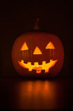 Halloween pumpkin glowing in the dark Royalty Free Stock Image