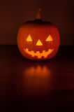 Halloween pumpkin glowing in the dark Royalty Free Stock Photo