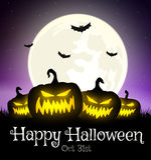 Halloween pumpkin on grass with moon Stock Photos