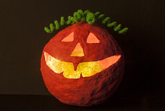 Halloween pumpkin with green hair decor Stock Images