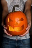 Halloween pumpkin in hand Royalty Free Stock Photo