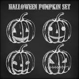 Halloween pumpkin hand drawn in chalk. Pumpkin chalk sketch on a black background Royalty Free Stock Image