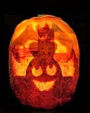 Halloween pumpkin. Handmade halloween pumpkin with skull, bat, and Bran (Dracula) castle on background stock photos