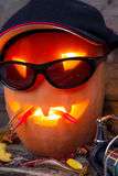 Halloween pumpkin in hat with fishing tackles Royalty Free Stock Photography