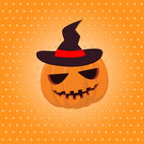 Halloween pumpkin in a hat on yellow Stock Photo