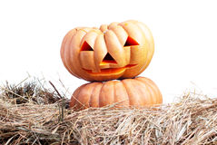 Halloween pumpkin on the hay on a white background isolated Royalty Free Stock Image