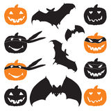 Halloween pumpkin head and bat. Stock Images