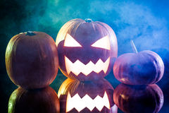 Halloween pumpkin head with blue and green smoke Stock Images