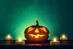 Halloween pumpkin head with candle light in darkness spooky back. Ground, halloween background Royalty Free Stock Photos