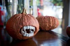 Halloween pumpkin head. Halloween carving ideas. Halloween pumpkin head decoration on table at home or coffee shop. Halloween carving ideas royalty free stock photography