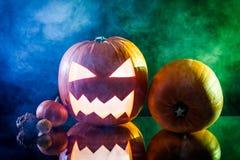 Halloween pumpkin head with color smoke Royalty Free Stock Photos