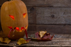 Halloween pumpkin head with fishing tackles Royalty Free Stock Photo