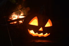 Halloween pumpkin head jack with fire. On the background Royalty Free Stock Images
