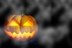 Halloween pumpkin head jack with fog Stock Photo