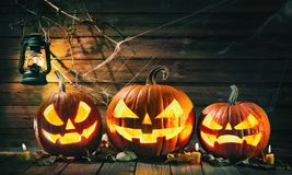 Halloween pumpkin head jack lantern with burning candles. In scary deep night royalty free stock photo