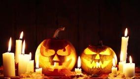 Halloween pumpkin head jack lantern with burning candles stock footage