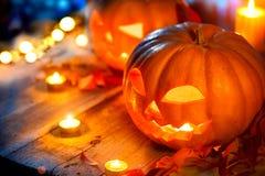 Halloween pumpkin head jack lantern with burning candles Royalty Free Stock Image